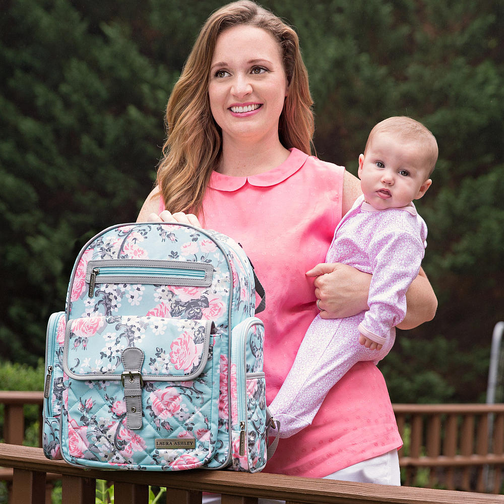1f61dbe7f37 This gorgeous Laura Ashley diaper bag is a handy backpack, with padded  straps for added comfort for mama, and it even has adjustable stroller  straps, too.
